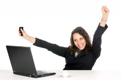 StockPodium_7701515_print_excited-young-business-woman-at-office-with-laptop-and-holding-1150x767[1]