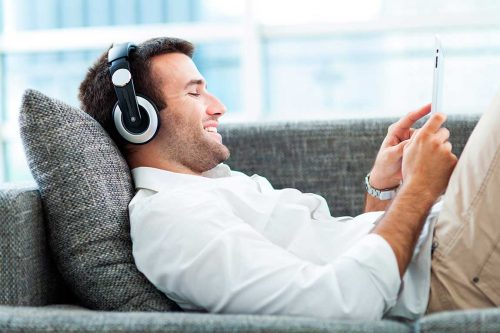 bigstock-Man-on-sofa-with-headphones-an-46762474[1]