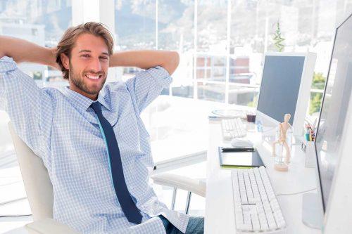 bigstock-Smiling-designer-at-his-desk-i-45846217[1]